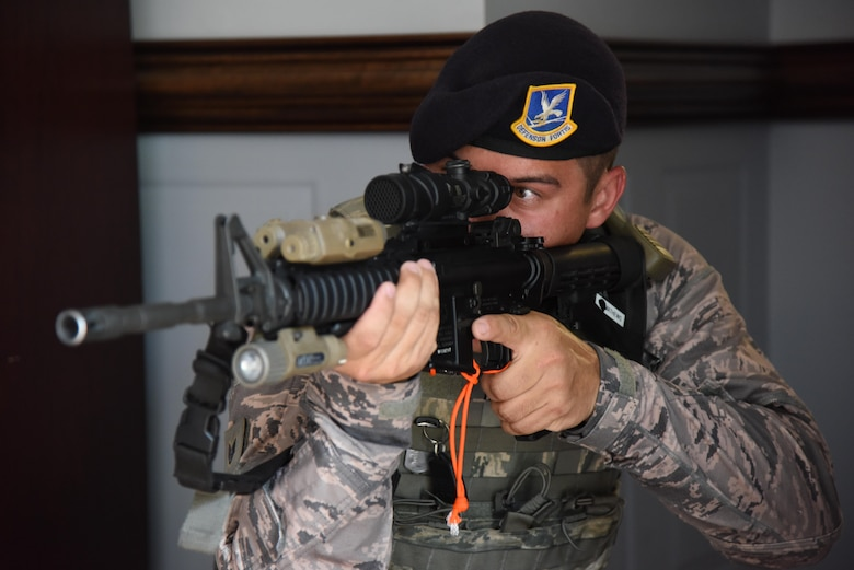 Staff Sgt. James Matthews II, 81st Security Forces Squadron flight sergeant, holds his post during an active shooter exercise at the Larcher Chapel Sept. 21, 2017, on Keesler Air Force Base, Mississippi. An active duty Air Force member simulated opening fire at the Arnold Medical Annex and the Larcher Chapel in order to test the base's ability to respond to and recover from a mass casualty event. (U.S. Air Force photo by Kemberly Groue)