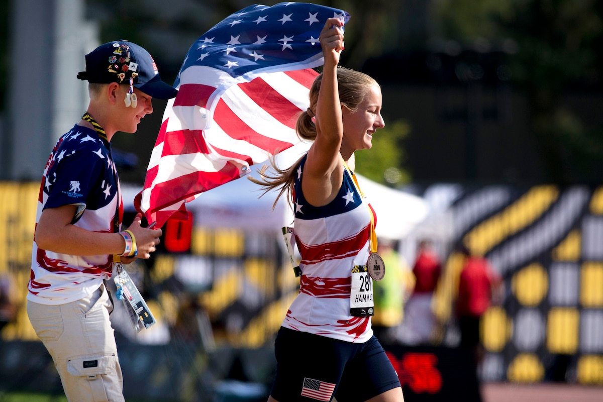 Marine Corps veteran Cpl. Jessica-Rose Hammack celebrates after receiving a bronze medal during the finals of track and field.