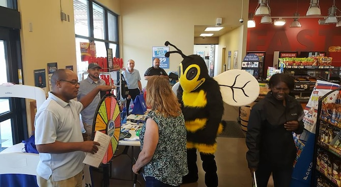 Eddie Bee Ready makes a visit to the Exchange Express gas station Sept. 22 as part of National Preparedness Month. Members of the 812th Civil Engineer Squadron Emergency Management Flight regularly dress up as the readiness mascot, including David Babcock who recently won the individual category of the Department of Defense's 2016 National Preparedness Awards. (Courtesy photo)