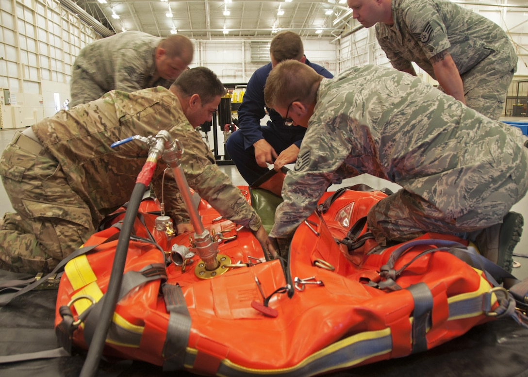 Maintainers from the 919th and 592nd Special Operations Maintenance Squadrons inspect the inner and outer fuel bladders on a cold bulk fuel delivery system