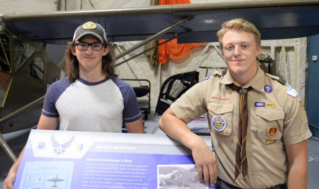 Andrew Worley and Ryan Ahrenstorff, eagle scouts with Troop 72 from Rapid City, stand next to a sign they assembled in Box Elder, S.D., Sept. 23, 2017. Worley and Ahrenstorff helped the South Dakota Air and Space Museum's Adopt-a-Plane Program which was established to keep the static displays in pristine condition for future generations to enjoy. (U.S. Air Force photo by Airman 1st Class Thomas Karol)