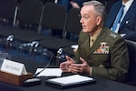Marine Corps Gen. Joe Dunford, chairman of the Joint Chiefs of Staff, waits to be seated during the Senate Armed Services Committee reconfirmation hearing.