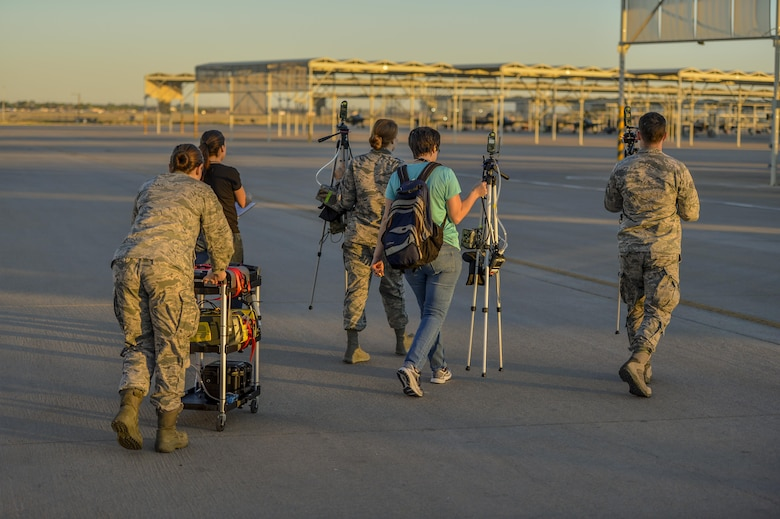 Members of Team Luke and Airmen from the USAF School of Aerospace Medicine relocated equipment on the flightline to perform air quality testing at Luke Air Force Base, Ariz., Sept. 20, 2017. The team members from the USAF School of Aerospace Medicine visited Luke for follow-up testing related to the F-35A Lightning II program. (U.S. Air Force photo/Airman 1st Class Caleb Worpel)