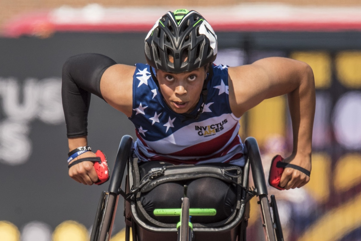 A Marine Corp veteran races in a wheelchair.
