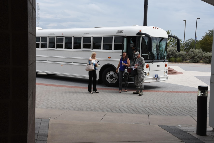 Megan McManus, the 17th Training Wing commander's wife, Elaine Sorrell, and U.S. Air Force Col. Jeffrey Sorrell, 17th Training Wing vice commander exit the bus at the Norma Brown building on Goodfellow Air Force Base, Texas, Sept. 25, 2017. The Norman Brown building was the final destination of the senior leader's immersion tour, concluding a visit to many locations showing the base's mission and operations. (U.S. Air Force photo by Airman Zachary Chapman)