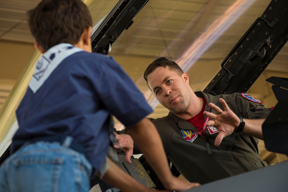 U.S. Air Force 1st Lt. Braxton Baker, 77th Fighter Squadron (FS) pilot, talks about the F-16CM Fighting Falcon to a cub scout at Shaw Air Force Base, S.C., Sept. 22, 2017. The 77th FS invited two local youth groups for a career day, where the children received a tour of the F-16 as well as the opportunity to go to Poinsett Electronic Combat Range, near Wedgefield, S.C., for a mission demonstration. (U.S. Air Force photo by Airman 1st Class Destinee Sweeney)