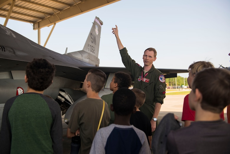 U.S. Air Force 1st Lt. Jack Howard, 77th Fighter Squadron pilot, gives a local youth group a tour around an F-16CM Fighting Falcon at Shaw Air Force Base, S.C., Sept. 22, 2017.