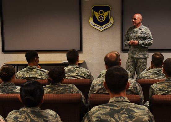 Col. Patrick Matthews, Eighth Air Force vice commander, speaks with Team Minot Airmen during a tour at Minot Air Force Base, N.D., Sept. 25, 2017. During the tour, Matthews visited the 5th Munitions Squadron, Combat Arms Training and Maintenance, Explosive Ordnance Disposal, Military Working Dogs, 23rd Aircraft Maintenance Unit, and the 5th Operations Support Squadron alert facility.(U.S. Air Force photo by Airman 1st Class Alyssa M. Akers)
