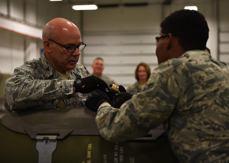 Col. Patrick Matthews, Eighth Air Force vice commander, builds an inert conventional bomb during a tour at Minot Air Force Base, N.D., Sept. 25, 2017. During the tour, Matthews visited the 5th Munitions Squadron, Combat Arms Training and Maintenance, Explosive Ordnance Disposal, Military Working Dogs, 23rd Aircraft Maintenance Unit, and the 5th Operations Support Squadron alert facility.(U.S. Air Force photo by Airman 1st Class Alyssa M. Akers)
