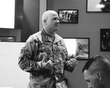 Col. Charles S. Armstrong, commander of 1st Armored Brigade Combat Team, 1st Infantry Division, speaks to Soldiers in leadership roles from his brigade during a Leader Seminar on suicide prevention Sept. 6 at Fort Riley Mission Training Center. The forum was formatted in a way to encourage leaders to speak up about the issue and brainstorm roadblocks they encountered with representatives from various organizations.