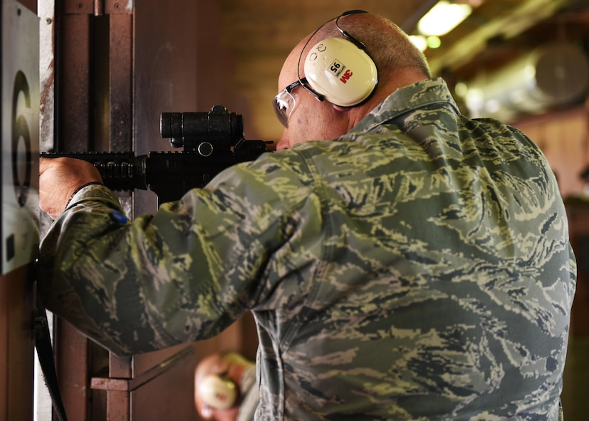 Col. Patrick Matthews, Eighth Air Force vice commander, fires an M4 carbine during a tour at Minot Air Force Base, N.D., Sept. 25, 2017. During the tour, Matthews visited the 5th Munitions Squadron, Combat Arms Training and Maintenance, Explosive Ordnance Disposal, Military Working Dogs, 23rd Aircraft Maintenance Unit, and the 5th Operations Support Squadron alert facility.(U.S. Air Force photo by Airman 1st Class Alyssa M. Akers)