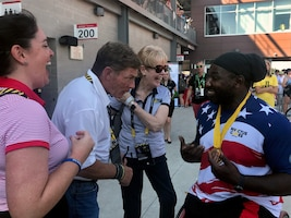 Ken Fisher, CEO and founder of Fisher House, jokes with Tony Pone, a medically retired Army specialist, after he earned gold medals in his disability category in the men's discus and shot put during the 2017 Invictus Games in Toronto, Sept. 24, 2017. DoD photo by Shannon Collins