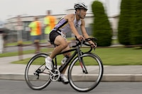 A participant in the 30th annual Marine Corps Air Station Iwakuni Triathlon hosted by Marine Corps Community Services Iwakuni, races during the 23-kilometer bicycle portion of the event at MCAS Iwakuni, Japan, Sept. 24, 2017. Marine Corps Community Services Iwakuni hosted the triathlon to energize the community and provide a positive experience through friendly competition. The event was composed of a 1-kilometer swim, a 23-kilometer bike ride and 8-kilometer run. (U.S. Marine Corps photo by Lance Cpl. Mason Roy)