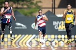 Patrick Roberts, a medically retired Air Force technical sergeant, competes in the men's 100-meter dash for Team Socom, the U.S. Special Operations Command Invictus Games team, at York-Lions Stadium in Toronto, Sept. 25, 2017. DoD photo by Marine Corps Sgt. Cedric R. Haller II