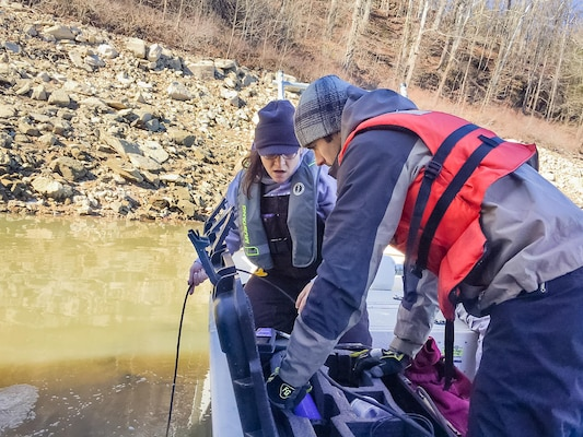 Louisville District Water Quality Biologist Jennifer Thomason and Huntington District Water Quality Biologist Thaddeus Tuggle collect field data to determine if the unexplained bloom of Daphnia lumoholtzi affected water quality parameters.