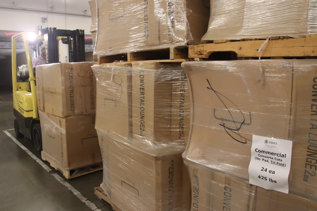 Cots are unloaded at DLA Distribution Warner Robins, Ga., for storage until dispatched to a FEMA-designated location.