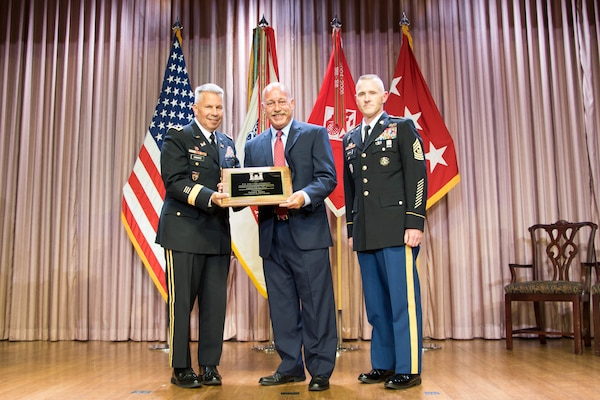 Lt. Gen. Todd T. Semonite, chief of engineers and commanding general of the U.S. Army Corps of Engineers, and USACE Command Sgt. Maj. Bradley Houston, present the USACE Engineer of the Year award to David Kiefer at the National Awards Ceremony in Washington, D.C., Aug. 2, 2017.