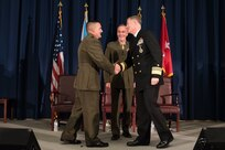 Maj Gen Padilla shakes hands with VADM Roegge with Gen Dunford looking on.