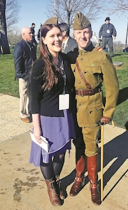 Capt. Robert Cogan, Headquarters and Headquarters Company, 2nd Armored Brigade Combat Team, 1st Infantry Division, with his wife, Chelsea, dresses up in World War I uniform and costume at the centennial ceremony of United States' entry into World War I at the National World War I Museum and Memorial in Kansas City, Missouri, April 6.