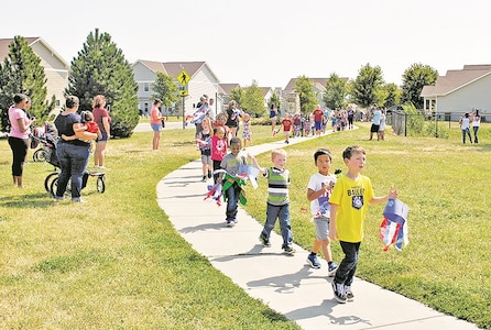 Students of Seitz Elementary School march through the Colyer-Forsyth neighborhood during their annual Freedom Walk Sept. 9. The walk was an outlet for students to show their pride and appreciation for the United States of America and the heroes found throughout the nation.