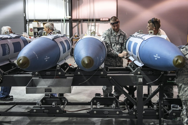Active-duty Tech. Sgt. Joseph Munis, 301st Fighter Wing, Naval Air Station Fort Worth Joint Reserve Base, Texas, builds GBU-31 bombs April 26 at Hill Air Force Base, Utah.