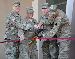 From left to right, Maj. Gen. Thomas Tempel Jr., commanding general, Regional Health Command-Central; Lt. Gen. Todd Semonite, commanding general, U.S. Army Corps of Engineers; Gen. Robert Abrams, commanding general, U.S. Army Forces Command; and Brig. Gen. Jeff Broadwater, commanding general, National Training Center and Fort Irwin, cut the ribbon during a Sept. 21 ceremony signifying the opening of the new Weed Army Community Hospital at Fort Irwin, California