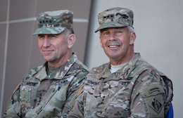 Gen. Robert Abrams, commanding general, U.S. Army Forces Command, left, and Lt. Gen. Todd Semonite, commanding general, U.S. Army Corps of Engineers, right, look out into the audience during a Sept. 21 ribbon-cutting ceremony for the new Weed Army Community Hospital at Fort Irwin, California.