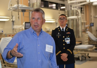 Lt. Gen. Todd Semonite, commanding general, U.S. Army Corps of Engineers, left, asks a question during a Sept. 20 tour of the new Weed Army Community Hospital at Fort Irwin, California.