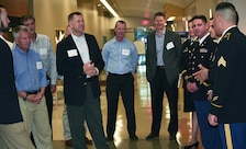 Soldiers brief Lt. Gen. Todd Semonite, commanding general, U.S. Army Corps of Engineers, second from left, and Maj. Gen. Thomas Tempel, commanding general, Regional Health Command-Central, third from left, about the new Weed Army Community Hospital during a Sept. 20 tour of the facility.