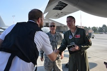 Col. Peter Boone, Air Commander of the 165th Airlift Wing, greets WTOC videographer Sean Evans before a C-130H aircraft departs Savannah to deliver supplies to St. Thomas, Virgin Islands Sept. 22, 2017. Evans is traveling along with a media team covering hurricane relief efforts on the ravaged Caribbean island. (U.S. Air National Guard photo by Staff Sgt. Chelsea Smith)