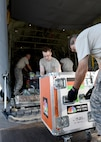 Airmen load NBC Nightly News equipment onto a Rhode Island Air National Guard C-130J cargo aircraft at Savannah Air National Guard Base, Georgia, Sept. 25, 2017. The NBC team embedded with the unit to cover the aftermath of Hurricane Maria. The trip included stops in St. Croix, Virgin Islands, and Puerto Rico. Media are authorized to embed with the National Guard to obtain news coverage of disaster relief so long as it does not affect missions. (U.S. Air National Guard photo/Master Sgt. Mike R. Smith)