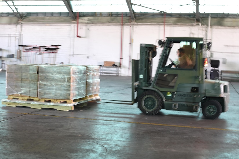 A forklift approaches a pallet.
