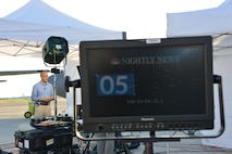 Lester Holt of NBC Nightly News broadcasts live from the flight line of the 165th Airlift Wing in Savannah, Georgia, Sept. 26, 2017. Holt and the NBC team covered the aftermath of Hurricane Maria traveling on a C-130H aircraft based out of the Rhode Island Air National Guard. The trip included stops in St. Croix, Virgin Islands, and Puerto Rico. (U.S. Air National Guard photo/Staff Sgt. Chelsea Smith)