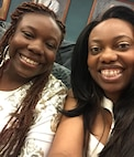 """Iyana and her mother, Tech. Sgt. Shonda Blanks, 375th Operations Support Squadron commander's support staff NCOIC, pose for a photo, showing off what Blanks calls Iyana's """"biggest, prettiest smile."""" (Photo courtesy)"""