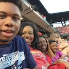 """Tyran, his mother, Tech. Sgt. Shonda Blanks, 375th Operations Support Squadron commander's support staff NCOIC, and his sisters Iyana and Nyla did things together as a family, including attending Cardinals games.  Blanks said spending time together was and is always important.  """"After she passed [Tyran] was telling me as he pulled his other sister close and everybody was crying and upset, 'We just gotta go hard for Iyana,'"""" said Blanks. """"So that's kind of been my mantra for myself - go hard for her. And that's another reason why I say, 'Okay, how can I contribute to her legacy?'"""" (Photo courtesy)"""