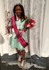"""Iyana holds a trophy and wears a sash for her win in the Miss Amazing Illinois, which seeks to increase the self-confidence of young women with disabilities.  """"She didn't want to be classified as having sickle cell disease; she wanted to be classified as Iyana,"""" said her mother, Tech. Sgt. Shonda Blanks, 375th Operations Support Squadron commander's support staff NCOIC. """"That's who she was as a person.  She was very sweet - had the biggest, prettiest smile, and was very nice to people.""""  (Photo courtesy)"""