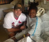 Adam Wainwright, St. Louis Cardinals' starting pitcher, visits Iyana during a hospital stay in relation to her Sickle Cell Disease.  (Photo courtesy)