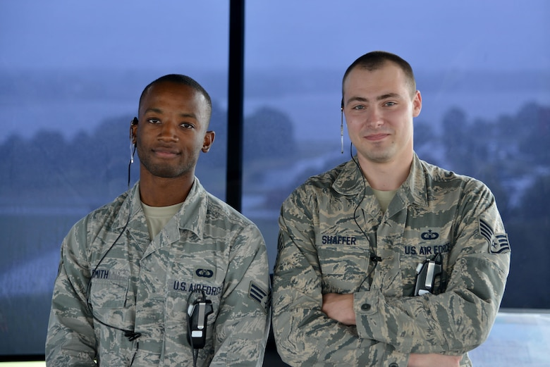 (From left) U.S. Air Force Senior Airman Richard Smith, 1st Operation Support Squadron air traffic controller, and Staff Sgt. Joshua Shaffer, 1st OSS tower watch supervisor pose for a photo at Joint Base Langley-Eustis, Va., Sept. 26, 2017.