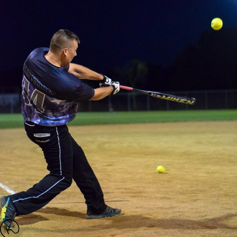 Tech. Sgt. Kory Strandquist, gets ahold of one during the Dept. of Defense softball tournament in San Antonio, Texas.(Courtesy Photo)