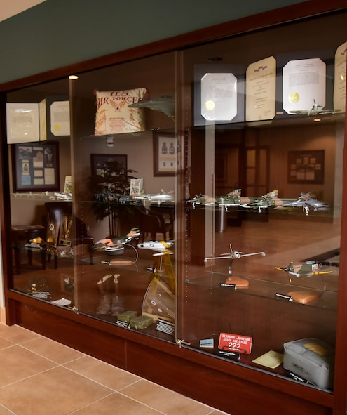 A display case filled with memorabilia and recently added model aircraft was dedicated, in the 4th Mission Support Group building, Sept. 27, 2017, at Seymour Johnson Air Force Base, North Carolina.
