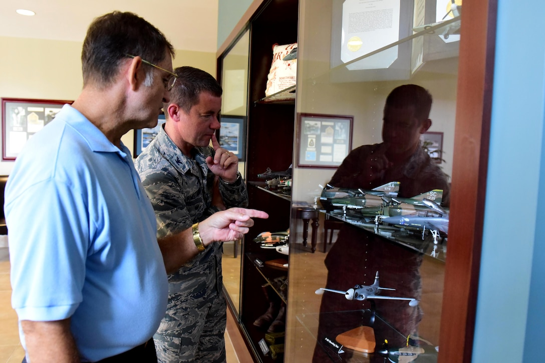 Retired Tech. Sgt. Bob Dedmon (left), discusses model aircraft with Col. Brian Armstrong, 4th Fighter Wing vice commander, Sept. 27, 2017, at Seymour Johnson Air Force Base, North Carolina.