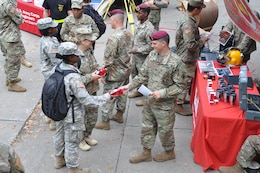 Solider from the 20th Engineer Brigade hand out memorabilia to cadets at Branch Week for the U.S. Military Academy at West Point.