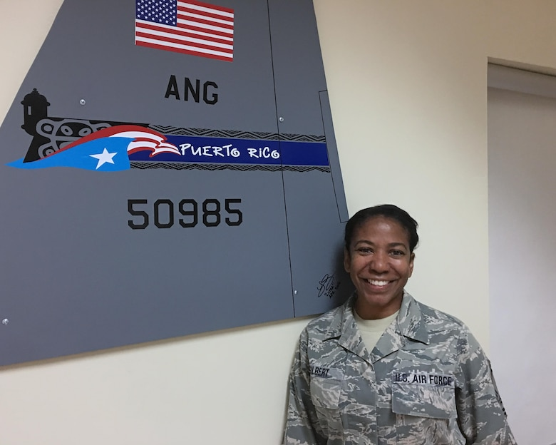Senior Master Sgt. Mildred Gilbert a member of the command post, takes a break in the operations building at Muniz Air National Guard Base, Puerto Rico to share her firsthand account of surviving a natural disaster. She is one of hundreds of local Air National Guard personnel who showed up at the base, seeking to service his community in the aftermath of Hurricane Maria, which hit Puerto Rico on Sept. 20, 2017. (U.S. Air National Guard photo by Tech. Sgt. Dan Heaton)