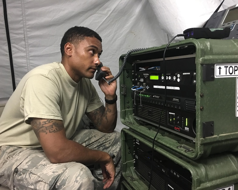 Staff Sgt. Helmut Woodberry of the Illinois Air National Guard's 126th Communications Flight works on a radio frequency control unit in a Joint Incident Site Communications Capability site at Muniz Air National Guard Base, Puerto Rico. The Air National Guard is working with many federal, territory and local agencies in response to Hurricane Maria. (U.S. Air National Guard photo by Tech. Sgt. Dan Heaton)
