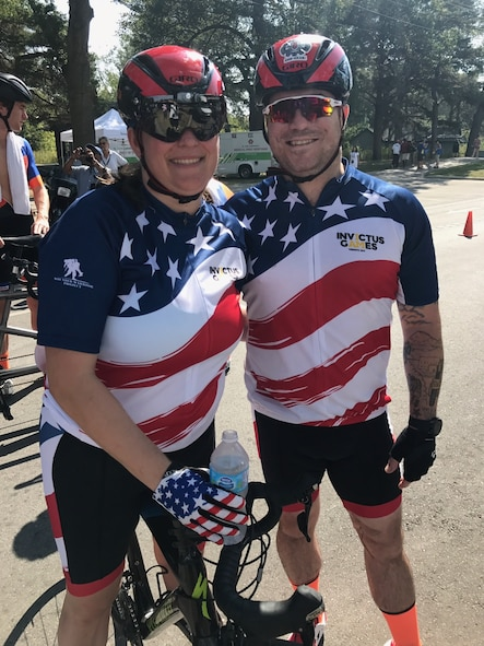 U.S. Air Force veteran Kyle Burnett, a former knowledge operations master sergeant, stands with her teammate and fiancé U.S. Air Force veteran Reese Hines, a former explosive ordnance disposal master sergeant, during the cycling competition of the 2017 Invictus Games in Toronto, Canada, Sept. 26, 2017. The duo met during a softball league sponsored by the Air Force Wounded Warrior (AFW2) program in Alaska in September 2015, and have been inseparable since. (Courtesy photo)