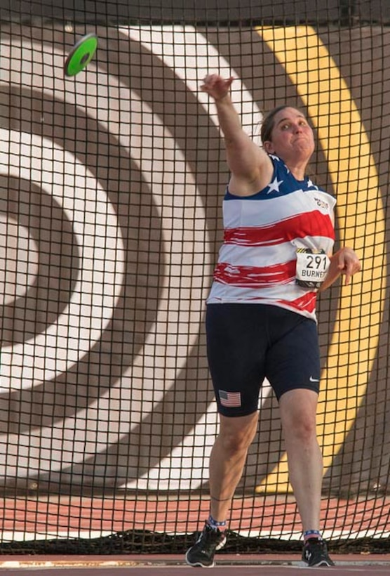 U.S. Air Force veteran Kyle Burnett, a former knowledge operations master sergeant, competes in the discus portion of athletics at the 2017 Invictus Games in Toronto, Canada, Sept. 24, 2017. Burnett sustained a permanent traumatic brain injury and was later diagnosed with posttraumatic stress disorder after a rocket landed roughly 10 feet away from her while stationed in Basra, Iraq in 2009. (Courtesy photo)