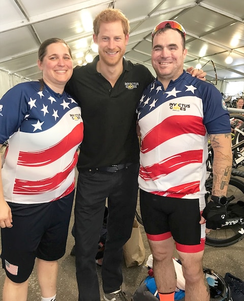 U.S. Air Force veteran Kyle Burnett, a former knowledge operations master sergeant, and U.S. Air Force veteran Reese Hines, a former explosive ordnance disposal master sergeant, stand with Prince Harry of Wales following a meet and greet during the cycling competition of the 2017 Invictus Games in Toronto, Canada, Sept. 26, 2017. Prince Harry took a moment to meet the couple, while learning more about their stories and journey to Invictus. (Courtesy photo)