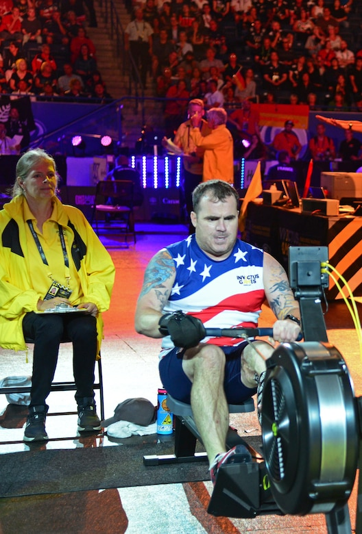U.S. Air Force veteran Reese Hines, a former explosive ordnance disposal master sergeant, competes during the indoor rowing competition at the 2017 Invictus Games in Toronto, Canada, Sept. 26, 2017. Reese was injured while deployed to Afghanistan when an improvised explosive device was remotely detonated, and roughly 20 pounds of explosives activated less than 2 feet away from him. (U.S. Air Force photo by Staff Sgt. Alexx Pons)