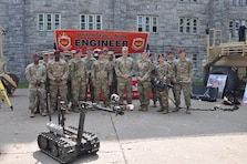 Soldiers from the 20th Engineer Brigade and the Army Corps' New York District, pose in front of the display section for the Engineer Regiment at the U.S. Military Academy at West Point Branch Week.