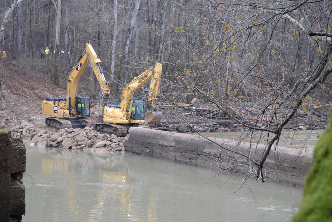 The excavators break up Dam No. 6 while building a work pad from which to remove material during the demolition, which was completed in April 2017.
